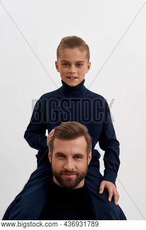 Vertical Narrow Shot Image Portrait Of Smiling Boy Child Son On Father Back Play Together. Happy You
