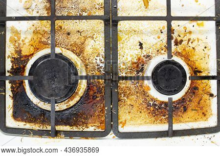 Dirty Gas Stove Surface. Two Gas Burners And Cast Iron Grate Of A Gas Oven Surrounded By Old Leftove