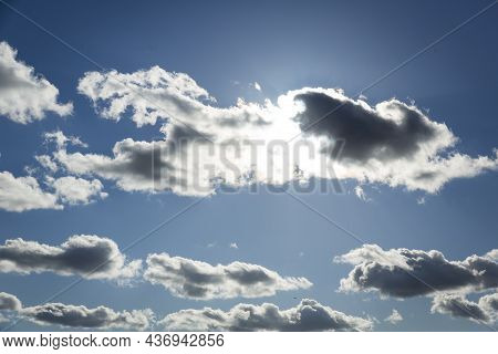 Heavenly Clouds, Blue Sky With Clouds Background. Sky With Clouds Weather Nature Cloud Blue. Sun Beh