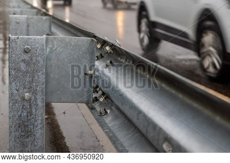 Underscrewed Nuts And Bolts In Highway Road Railing Close-up