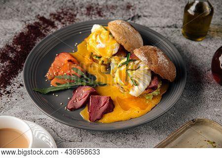 Portion Of Eggs Benedict With Beef Ham