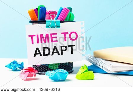 On A Blue Background - A Stand With Bright Markers, Notepads And Multi-colored Crumpled Pieces Of Pa