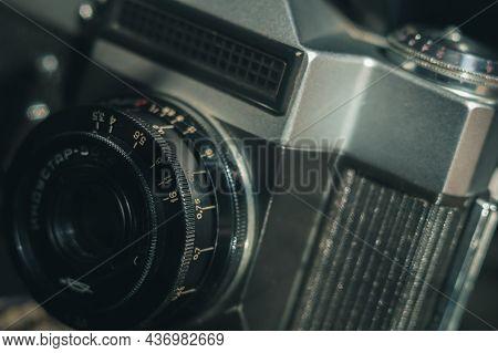 Soviet Manual Lens Industar 50-2 On A Film Camera Zenit-e. Black Background, Copy Space, Deep Shadow