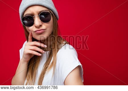 Closeup Of Young Positive Thoughtful Emotional Beautiful Dark Blonde Woman With Sincere Emotions Wea