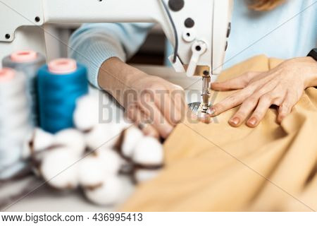 Clothing Repair. Worker In A Garment Factory, Fashionable And Sustainable Production. Fix Dress.