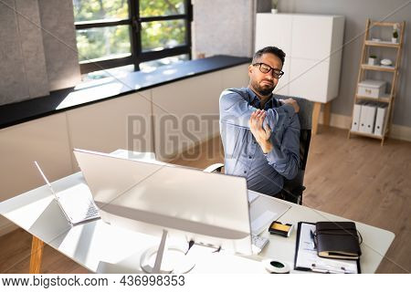 Shoulder Pain And Posture. Man Suffering Near Workstation Computer
