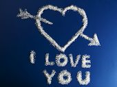I Love You phrase made fromon sugar on blue background poster