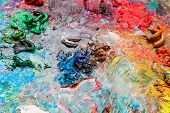 The artist's palette for mixing colors close-up. poster