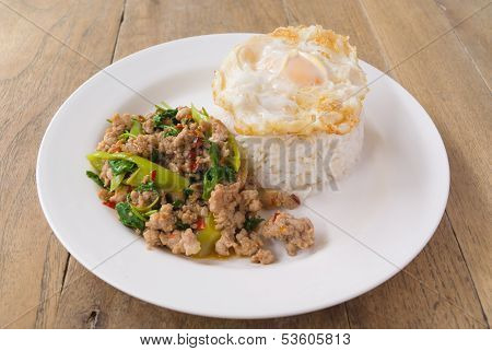 Stir Fried Chicken With Basil Leaf Serve With Fried Egg And Cooked Rice