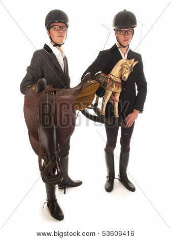 Two Handsome Young Men With Horses Outfit And A Rocking Horse
