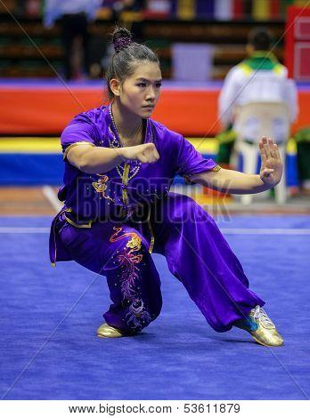 KUALA LUMPUR - NOV 03:  Tai Cheau Xuen of Malaysia shows her fighting style in the 'Nan quan compulsory' event at the 12th World Wushu Championship on November 03, 2013 in Kuala Lumpur, Malaysia.