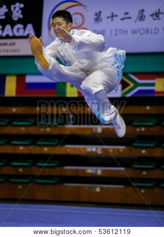 KUALA LUMPUR - NOV 03: Jonathan Leung of Canada shows his taiji quan martial arts moves in the 'taiji quan' event at the 12th World Wushu Championship on November 03, 2013 in Kuala Lumpur, Malaysia.