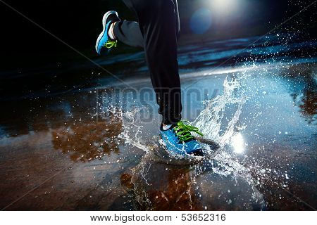 Single Runner Running In Rain