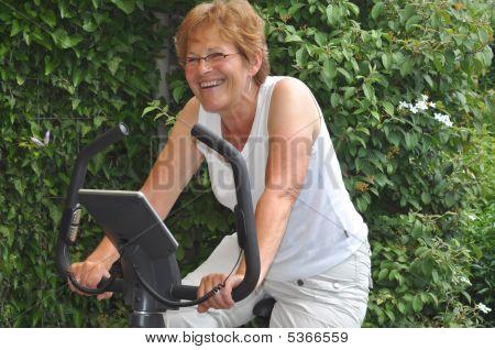 Laughing Senior At Hometrainer