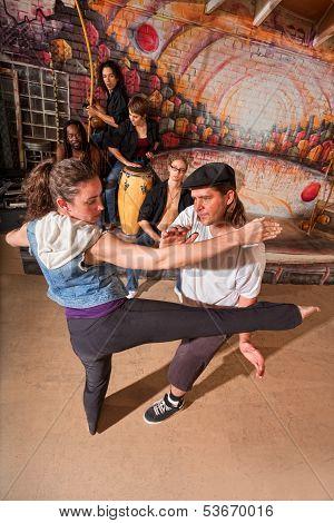 Capoeira Instructor Teaching Kicks