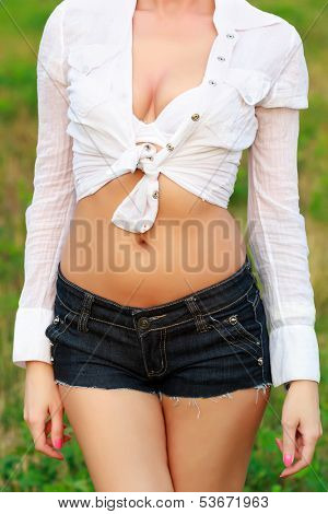 Busty woman posing outdoors