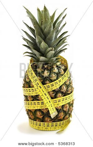 Pineapple With Measuring Tape Isolated Over White.