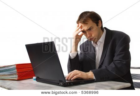 Young Man Works On Laptop, Close To Breakdown