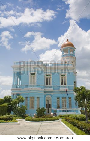 Beautiful Blue Palace With A Cloudy Sky