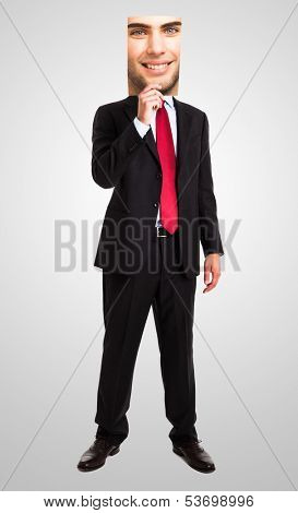 Businessman hiding behind another face