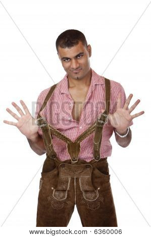 Sexy Man With Oktoberfest Leather Trousers Shows Braces