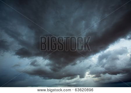 Stormy clouds gray low key sky with dramatic shadows and lights