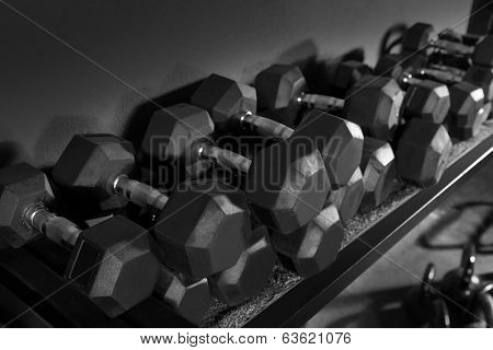 Dumbbells and Kettlebells weight training equipment at gym