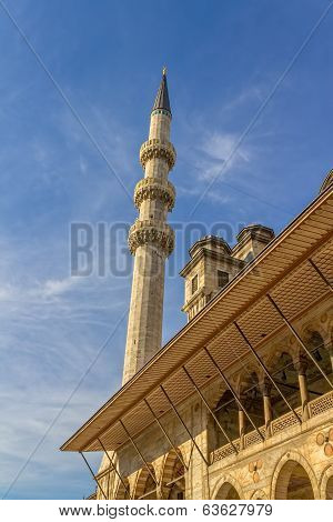 New Mosque (Yeni Cami) minaret in the Eminonu district of Istanbul, Turkey. poster