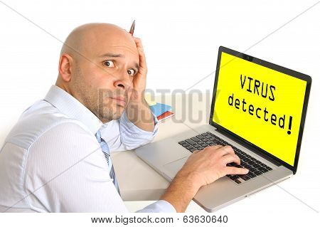 Worried Young Business Man At Computer Infected With Virus