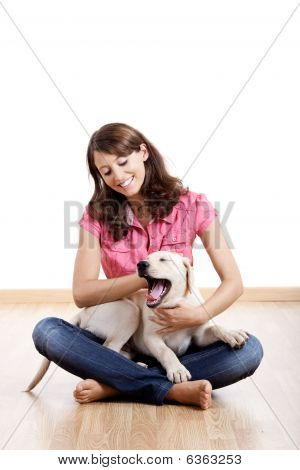Beautiful young girl playing with a nice cute dog poster
