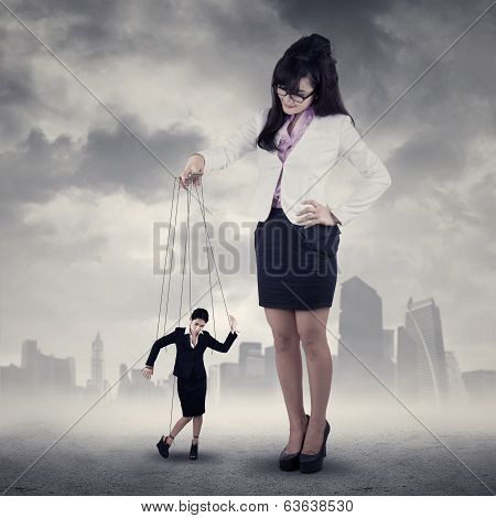 Businesswoman Controlled By Her Boss