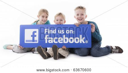 Kids holding Facebook find us sign