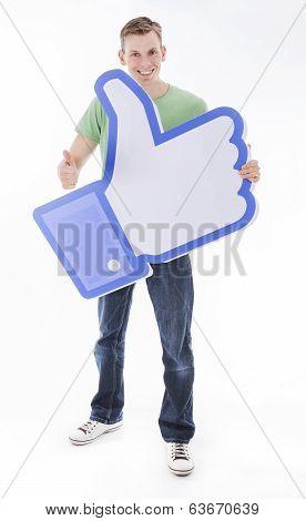 Man holding Facebook like thumb