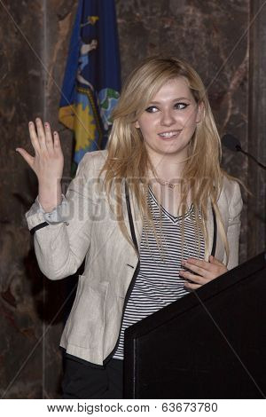 NEW YORK-APR 21, 2014: Actress & Project Sunshine Ambassador Abigail Breslin speaks at the ceremony where she will light the Empire State Building in yellow in honor of Project Sunshine Week.