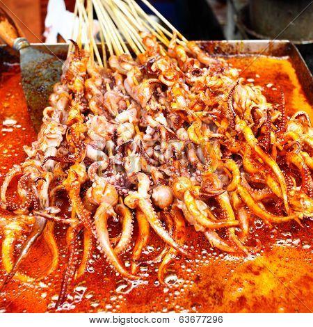 Frying of squid's tentacles skewers in Shanghai, China