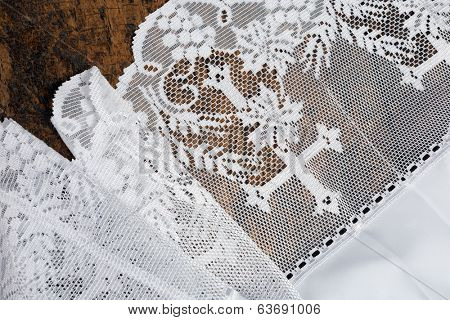 Closeup of a white lace surplice or priest gown traditionally worn over a cassock