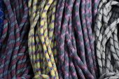 many old used rock climbing ropes in bundles poster