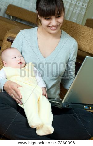 Mother, Baby And Laptop