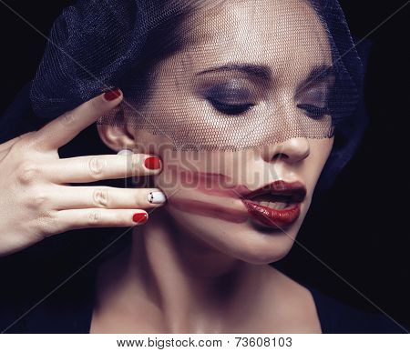 beauty brunette woman under black veil with red manicure close up, grieving widow, halloween makeup poster