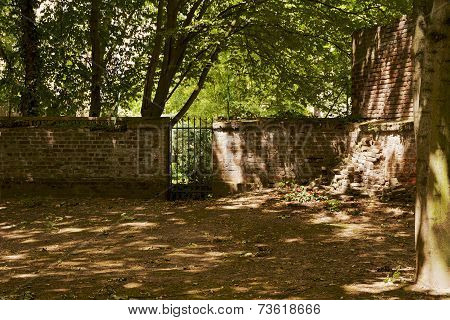 cemetery wall with gate
