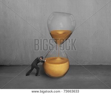 Male Hand Push Tilt Hour Glass