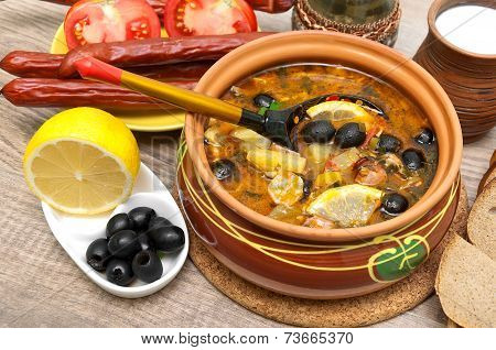 Dish Of Russian Hodgepodge Soup And Other Food On A Wooden Table