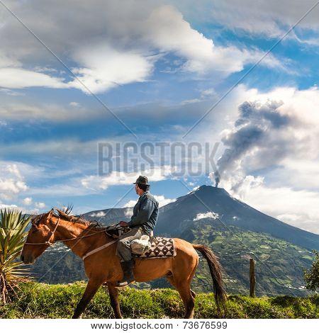 Banos, Ecuador - December 10: Unrecognizable Farmer On A Horse Looking At The  Tungurahua Volcano