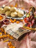 Indian rupees bank notes in Diwali puja with a Goddess of wealth -laxmi poster
