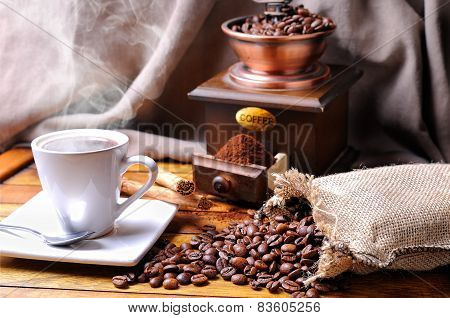Composition With A Cup Of Coffee, Beans And Coffee Grinder