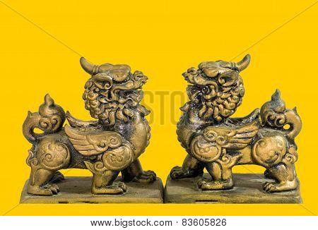 Chinese talisman figurine yellow background