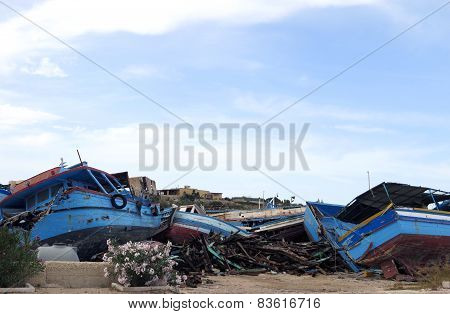Broken Ancient Shipwrecks After The Disembarkation Of Refugees