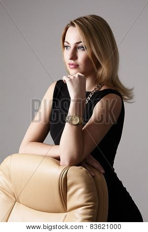 Attractive Woman Leaning On Armchair