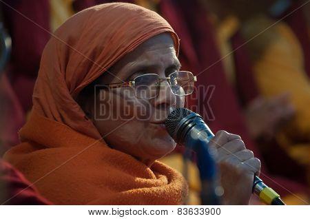 Woman Sings A Prayer On Ganga Aarti Ceremony In Parmarth Niketan Ashram