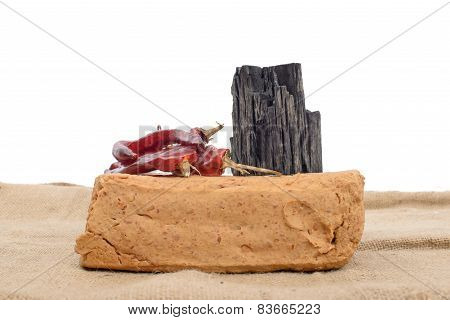 meju (fermented soybean lump) and basic ingredients to make doenjang isolated on white. poster